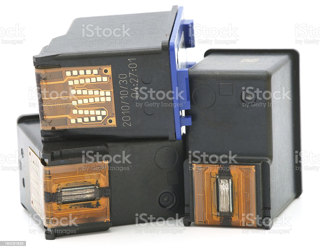 Three used ink cartridges on white background royalty-free stock photo