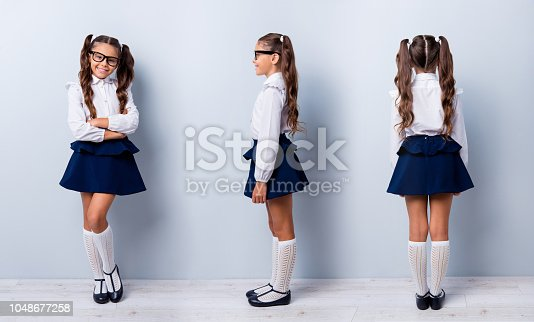 istock Three variant rear behind half view photo portrait of sweet clever charming nice glad satisfied charming positive girl standing isolated on gray background 1048677258
