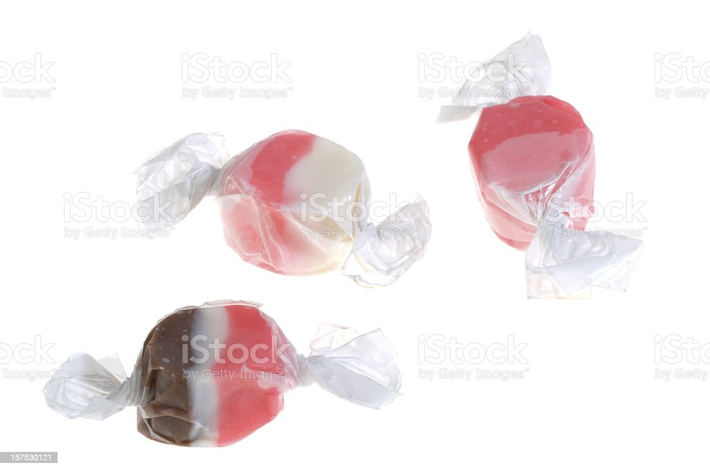 Three varied flavored salt water taffy on white background stock photo