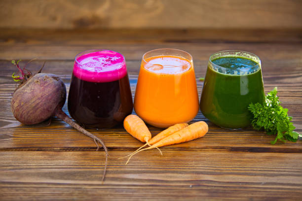 three vegetable juice in glass cup on wooden background three vegetable juice in a glass cup on a wooden background vegetable juice stock pictures, royalty-free photos & images