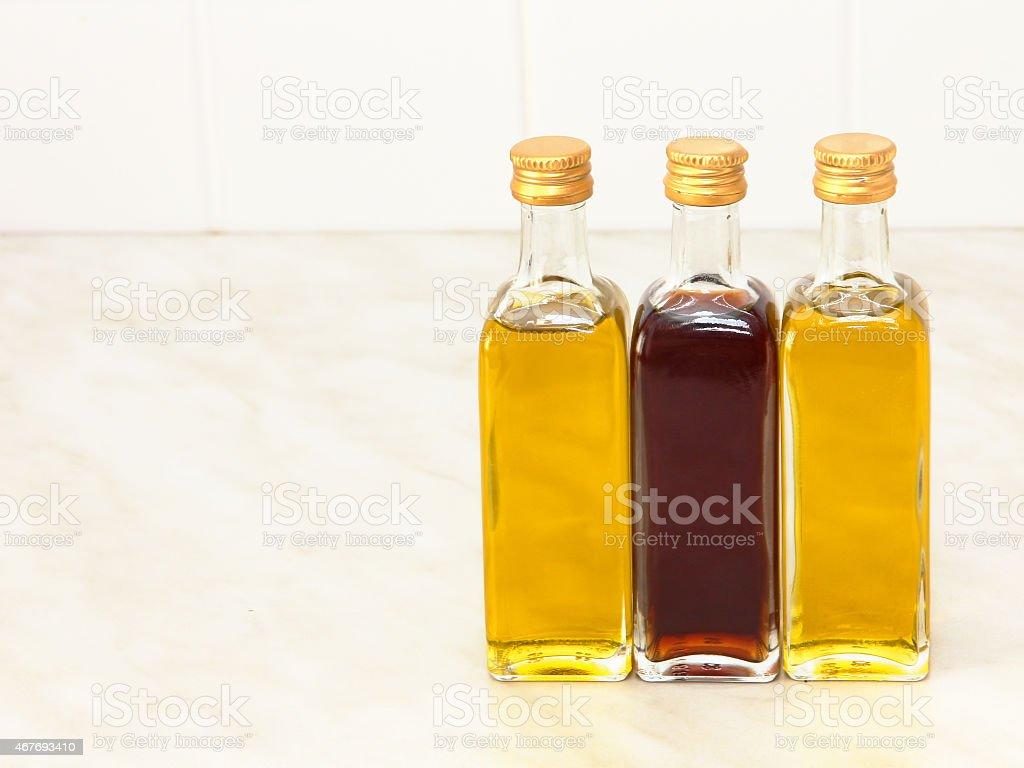 Three Vegetable Oil Bottles On White Kitchen Table. Royalty Free Stock Photo