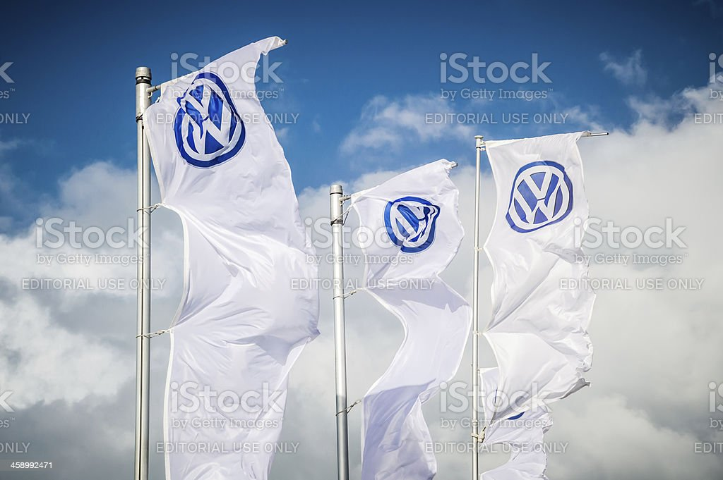 Three Volkswagen flags in the wind stock photo