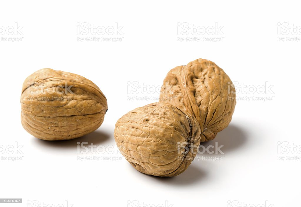 three walnuts isolated on white royalty-free stock photo