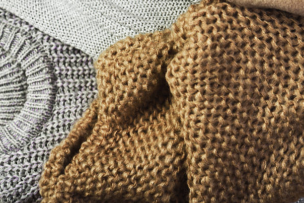three warm sweaters on a full background. – Foto
