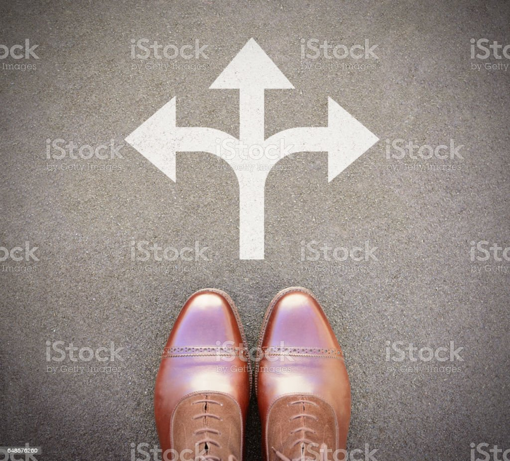 Three way arrows choise. top view of perfect kept business shoes. stock photo