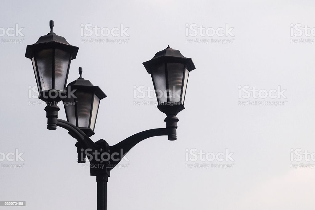 three ways electric lamp post against clear blue sky stock photo