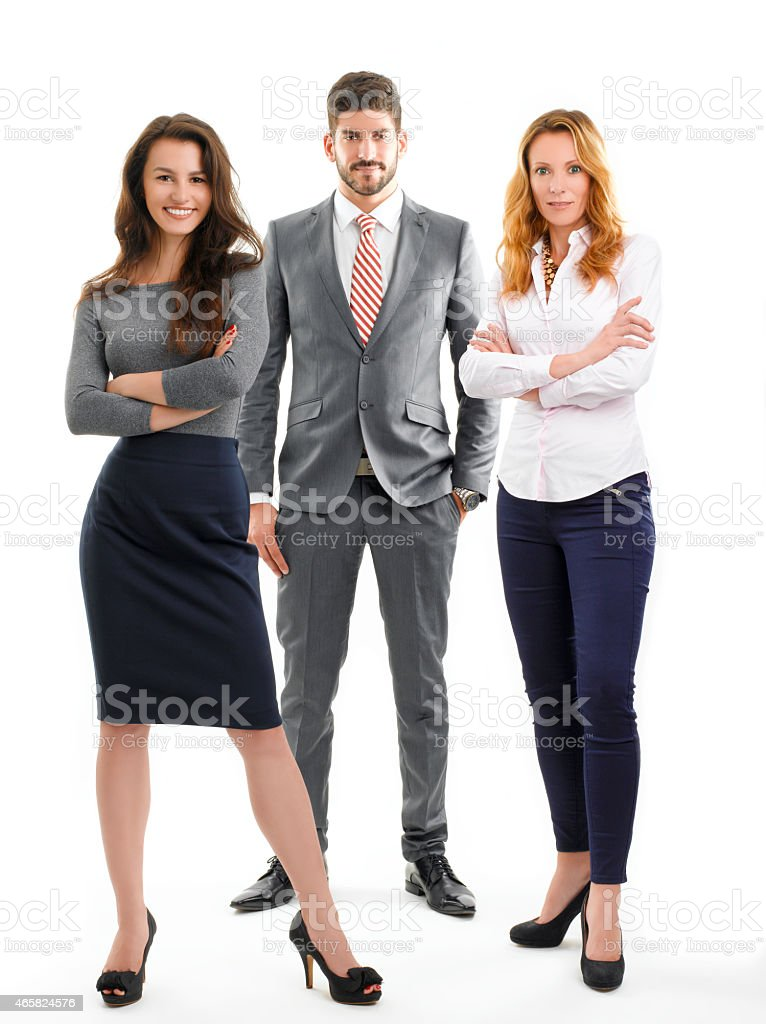 Three well dressed business people, one male and two females stock photo