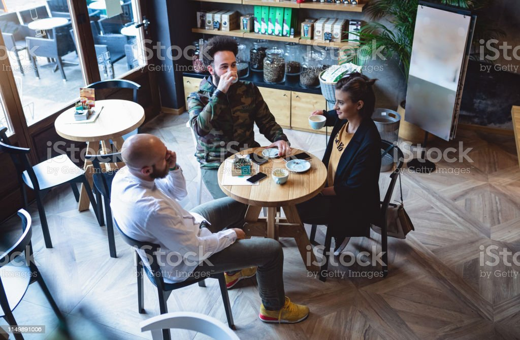 Three Well Dressed Friends Discussing About Some Work Ideas Stock Photo Download Image Now Istock