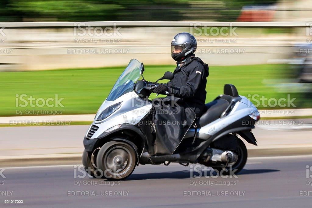 Three wheeled scooter stock photo