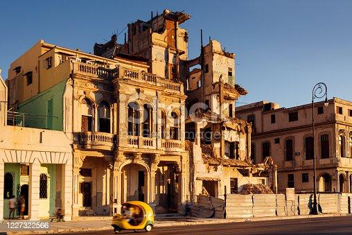 three wheeled Taxi speeding along the Malecon in Havana, Cuba
