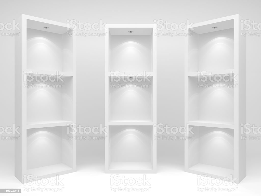 Three white cd racks or bookcases on a white background stock photo