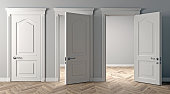 istock Three white classic doors on the wall 1266925660