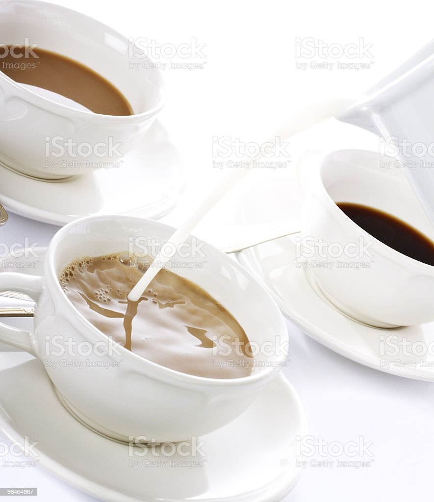 Three White Cups of Coffee for Breakfast and a Jar royalty-free stock photo