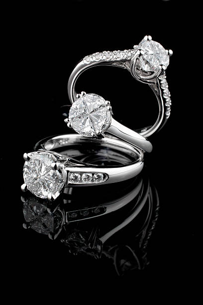 Three white gold diamond rings on black background  ring jewelry stock pictures, royalty-free photos & images