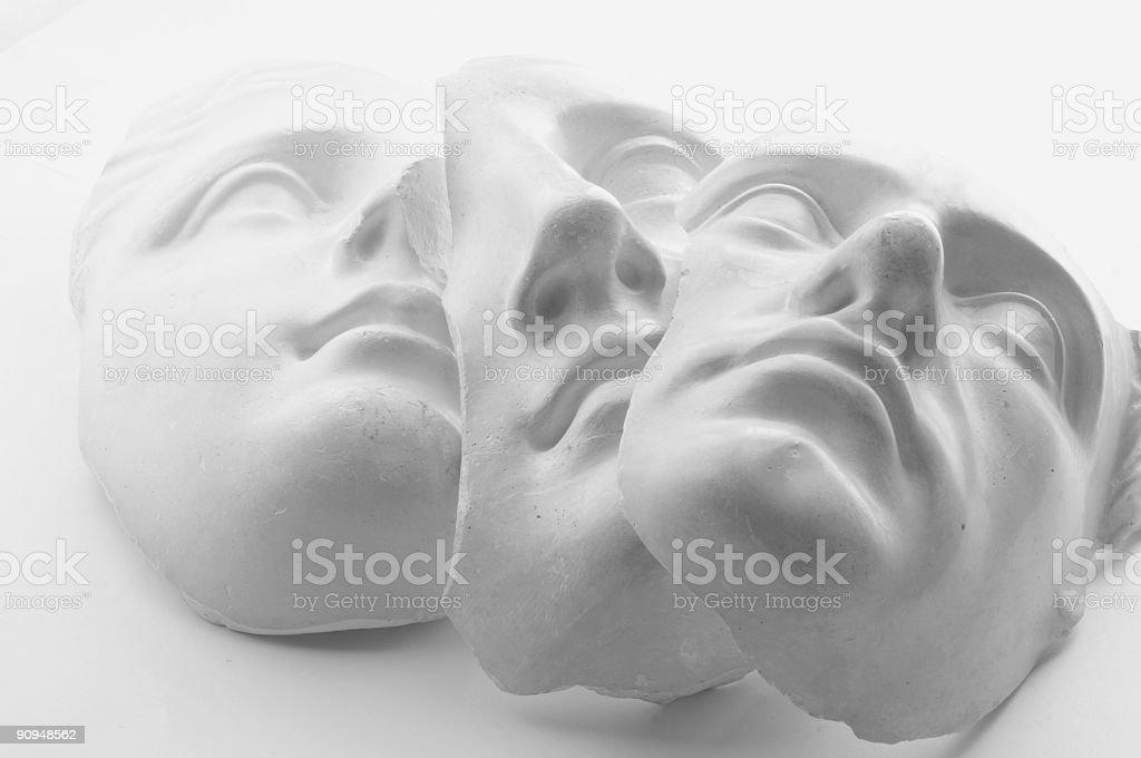 three white gypsum faces stock photo