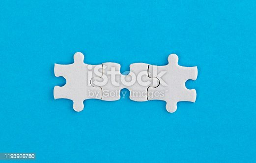 Three white jigsaw pieces on blue background.