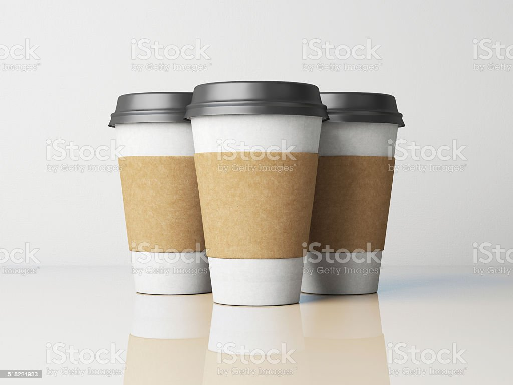 Three white paper cups with black caps. With reflections stock photo