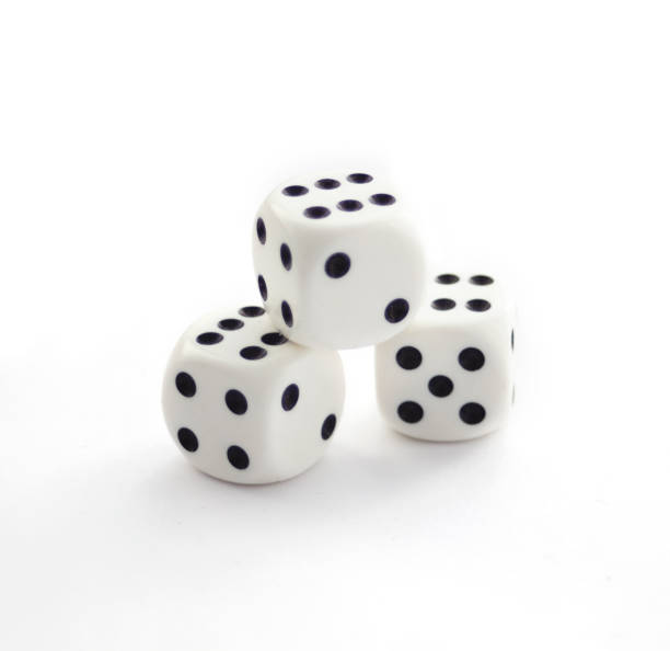 Three white plastic dices isolated on white stock photo