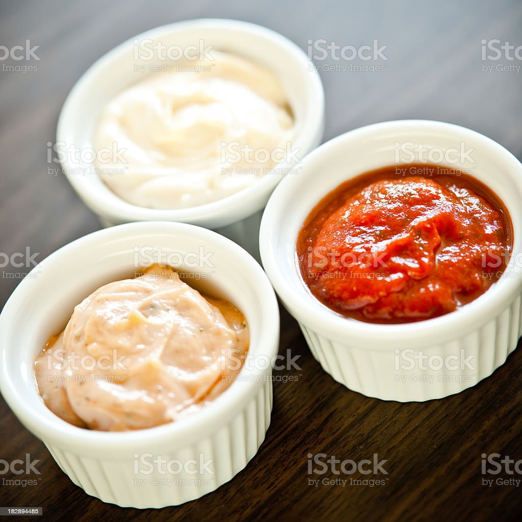 Three white ramekins filled with different sauces royalty-free stock photo