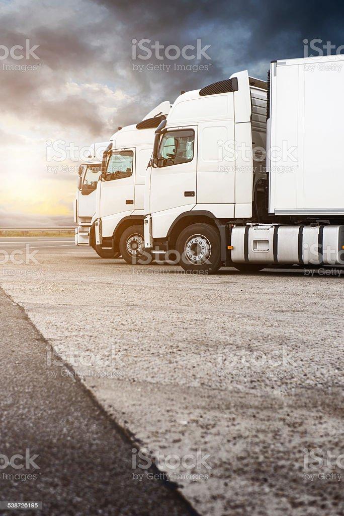Three white trucks in a row stock photo