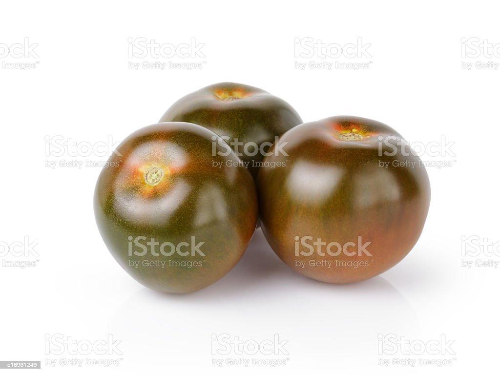 three whole kumato tomatoes stock photo