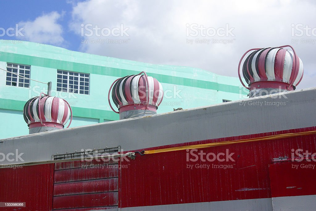 three wind driven ventilators on mobile canteen roof royalty-free stock photo