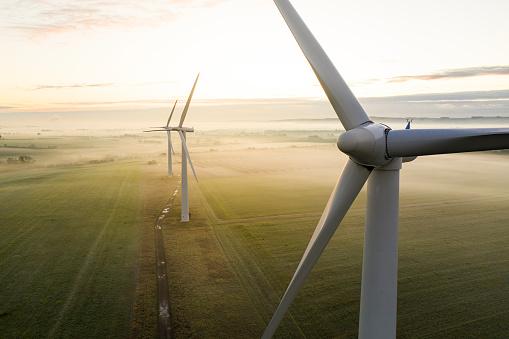 Three wind turbines at sunrise