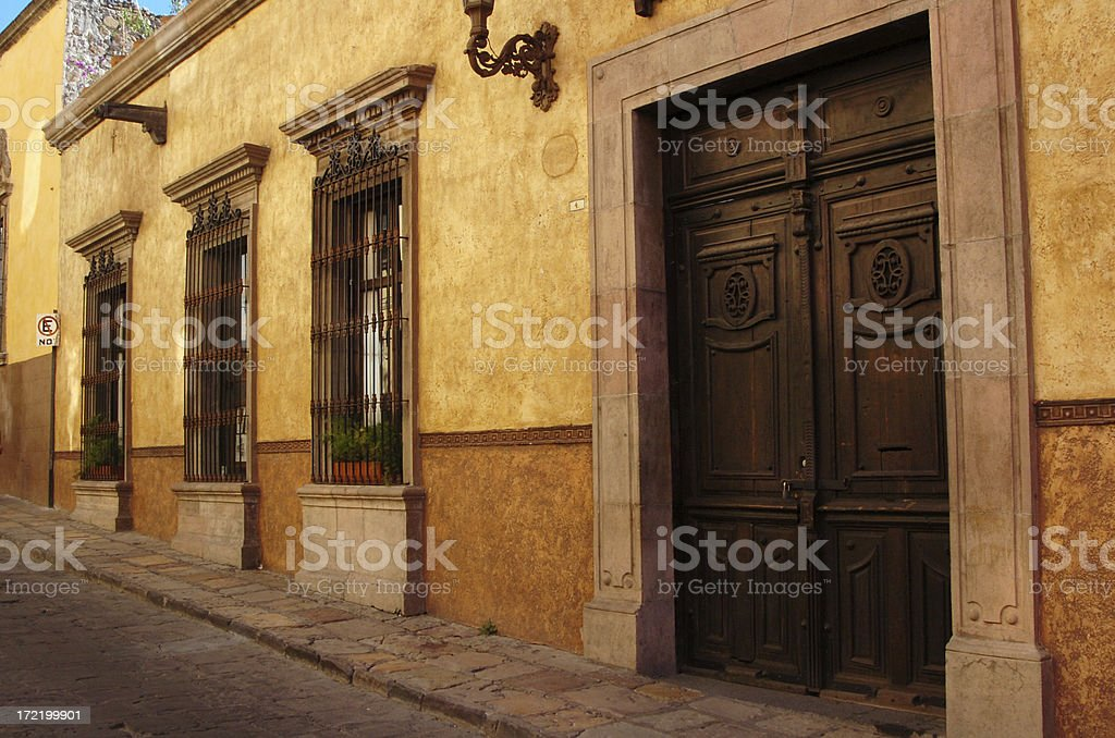 Three windows and a door royalty-free stock photo