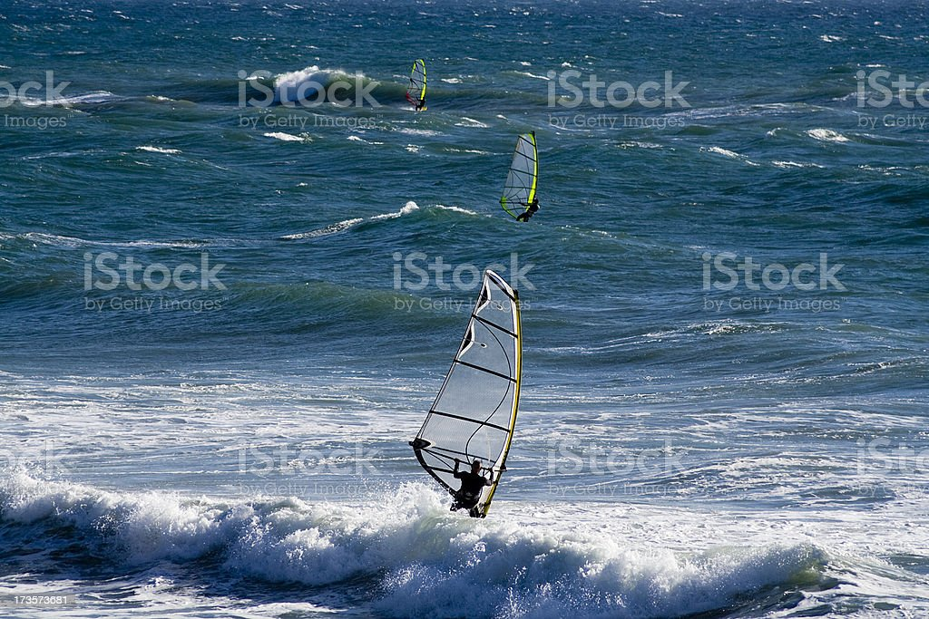 Three windsurfers in ocean. Malibu, CA stock photo