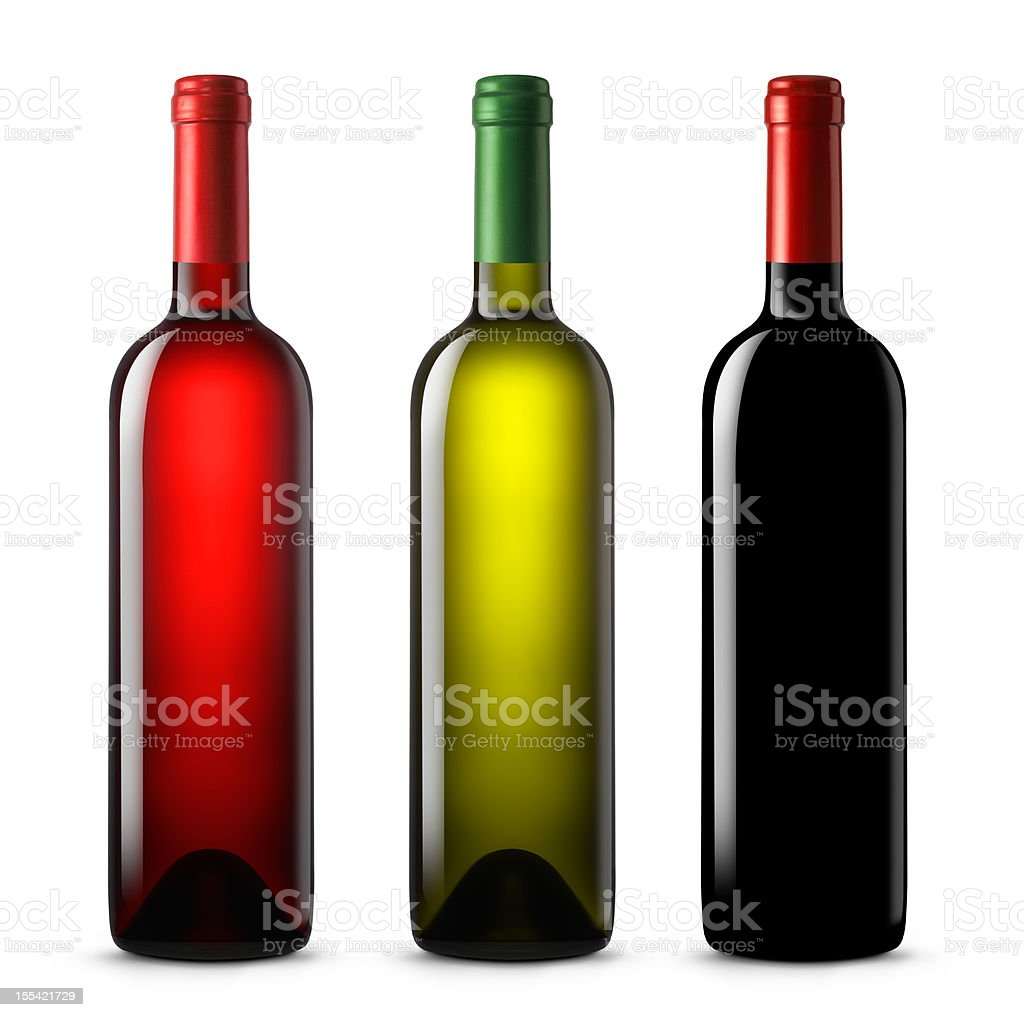 Three wine bottles in various colors on a white background royalty-free stock photo