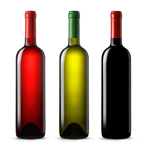 Three wine bottles in various colors on a white background stock photo