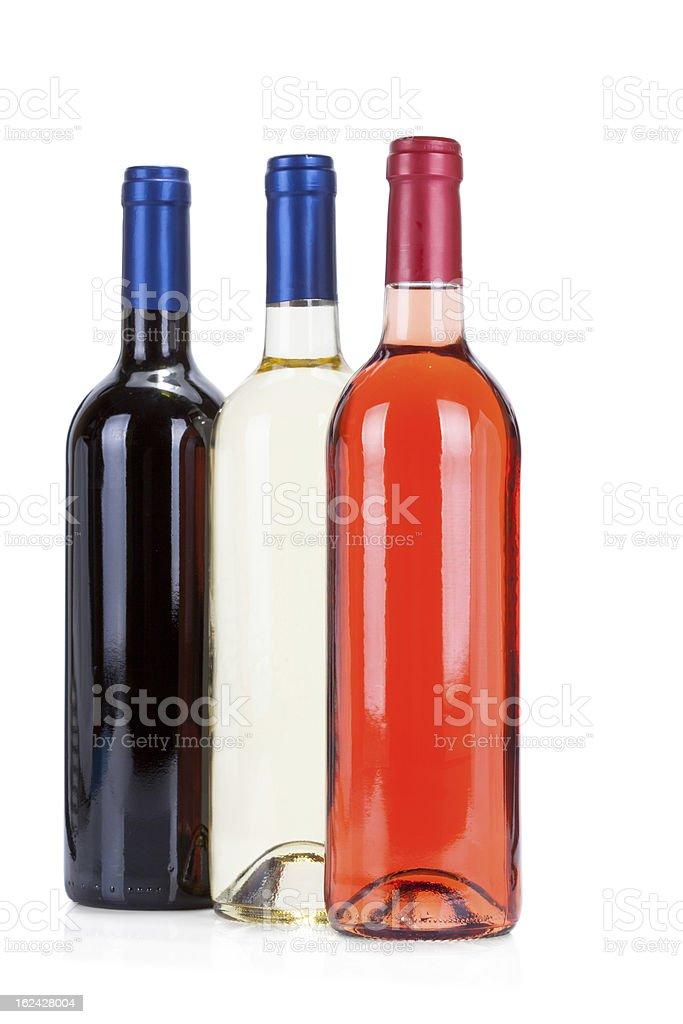 Three wine bottles on white stock photo