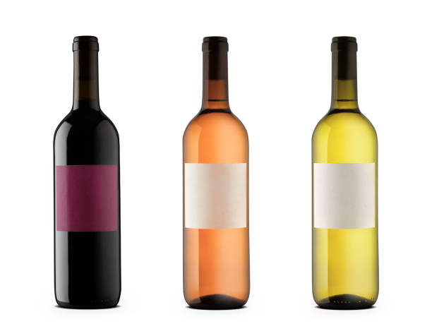 Three wine bottles with blank labels stock photo