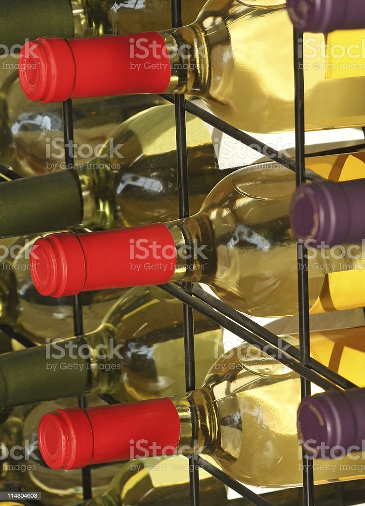 Three Wine Bottles with Red Caps royalty-free stock photo