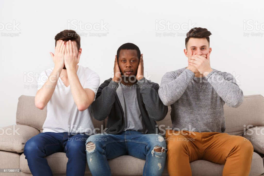 Three wise monkey scene showed by young men in casual stock photo