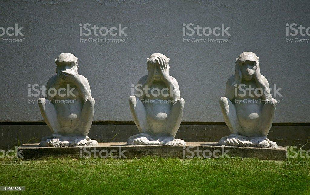 Three Wise Monkeys stock photo