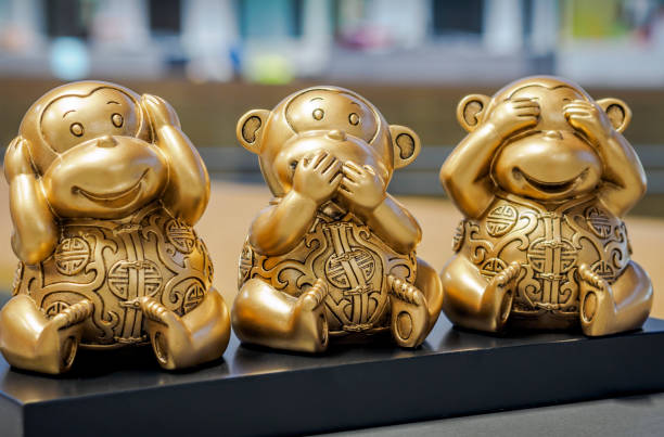 "Three Wise Monkeys Three Wise Monkeys - Figurine of chimps depicting ""see no evil"", ""speak no evil"" and ""hear no evil"" postures. hear no evil stock pictures, royalty-free photos & images"
