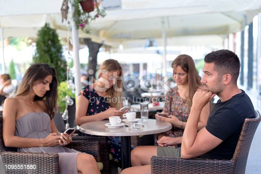 649172938istockphoto Three women addicted to their smartphones. They do not pay attention to their friend. 1095551880