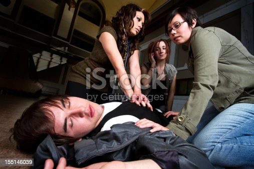 istock Three women administer CPR to a young man 155146039