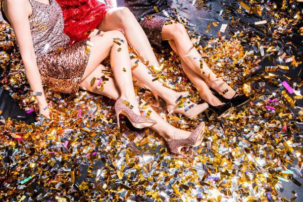 three women at the party - glitzer absätze stock-fotos und bilder