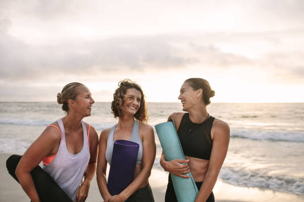Three women carrying yoga mats standing at the beach picture id1032702508?b=1&k=6&m=1032702508&s=612x612&w=0&h=wzijtgsgxsnvp1nhdrzieqgttmjqege5vjxtcv9mocm=