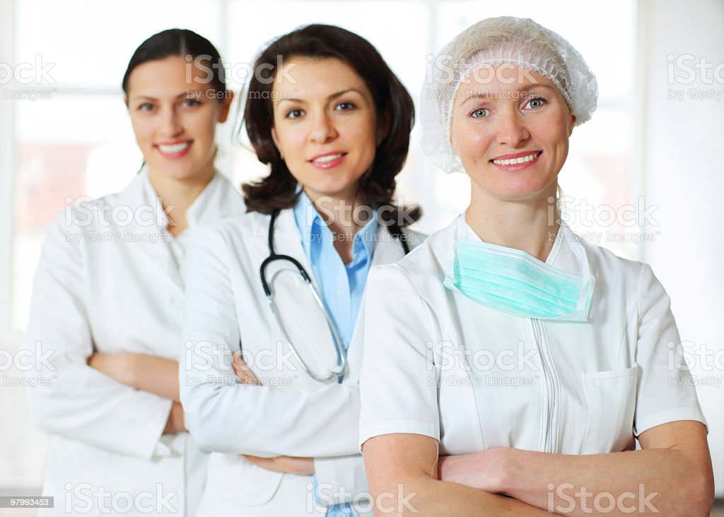 Three women doctors standing in a row. royalty free stockfoto