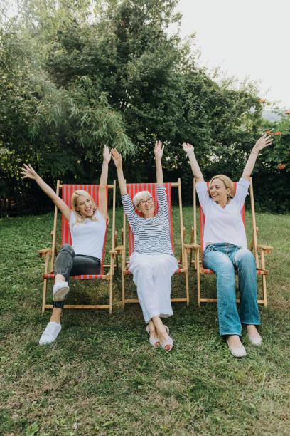 Three women enjoying outdoors, talking and laughing stock photo