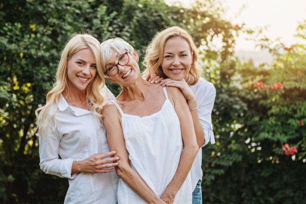 Three women enjoying outdoors, talking and laughing stock photo
