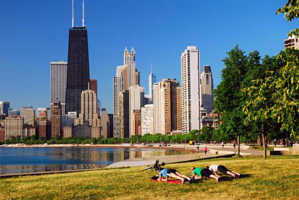 Three women exercise along the Chicago Lakefront stock photo