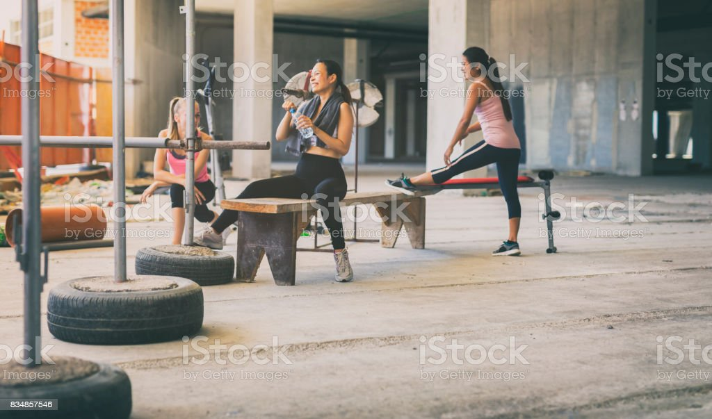 Three women exercising in an urban gym stock photo & more pictures