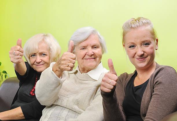 Three women. Happy and smiling family. stock photo