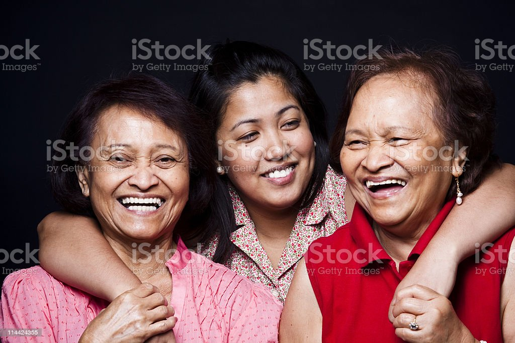 Three women hugging and smiling royalty-free stock photo