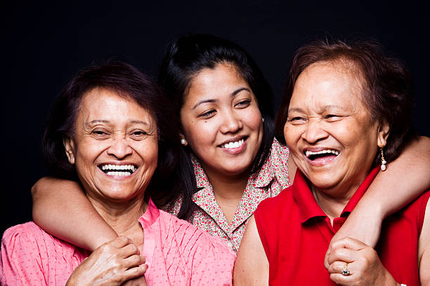 Three women hugging and smiling stock photo