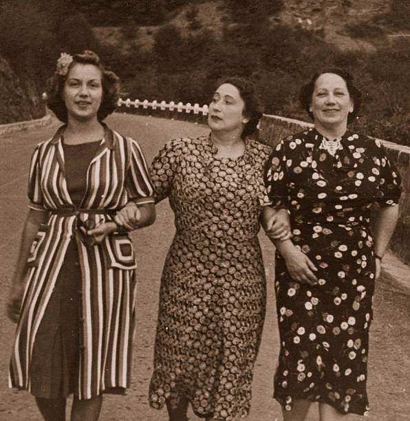 three women on the road in 1931.sepia toned - sepia stock photos and pictures